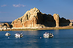 AZ, Arizona Lake Powell, near Grand Canyon National Park, scenic, fishing boats in foreground, Utah border in background  .Photo Copyright: Lee Foster, lee@fostertravel.com, www.fostertravel.com, (510) 549-2202.Image: azlkpo212