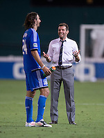 D.C. United head coach Ben Olsen talks to Alan Gordon (24) of the San Jose Earthquakes after a Major League Soccer game at RFK Stadium in Washington, DC.  D.C. United defeated San Jose Earthquakes, 1-0.