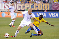 Michael Bradley (4) of the United States and Ramires (8) of Brazil battle for the ball. The men's national team of Brazil (BRA) defeated the United States (USA) 2-0 during an international friendly at the New Meadowlands Stadium in East Rutherford, NJ, on August 10, 2010.