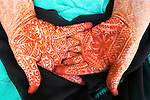 Traditionally henna is used on the hands and feet; this tradition probably developed because the color takes best and lasts longer on the thicker skin, Morocco.