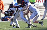 Nov 27, 2010; Charlottesville, VA, USA;  Virginia Tech Hokies wide receiver Jarrett Boykin (81)is tackled by Virginia Cavaliers linebacker Steve Greer (53) during the game at Lane Stadium. Virginia Tech won 37-7. Mandatory Credit: Andrew Shurtleff-