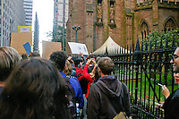 Protester march next to Trinity Church Wall Street, during the Occupy Wall Street Protest in New York City October 6, 2011.