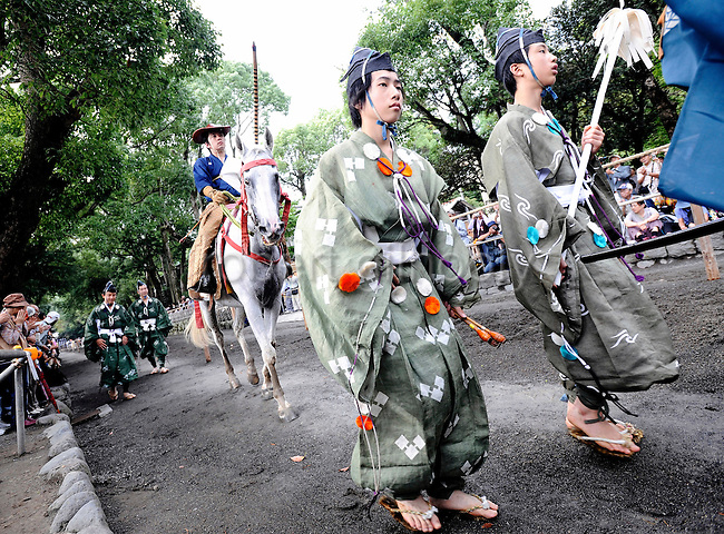 A horseback archer dressed in a traditional hunting garb is escorted along a 255-meter course during the Yabusame Shinji ritual at Tsurugaoka Hachimangu shrine in Kamakura, near Tokyo on 17 Sept. 2008. The ritual, which involves several riders on horseback firing arrows at targets while galloping at speed, dates back to the 12th century and is aimed at appeasing the numerous gods that guard Japan. It was initiated by Kamakura shogun Minamoto no Yoritomo  in an attempt to improve his samurai warrior's appalling archery skills...Photographer: Robert Gilhooly
