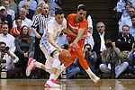 26 January 2015: Syracuse's Michael Gbinije (0) tries to steal the ball from North Carolina's Justin Jackson (left). The University of North Carolina Tar Heels played the Syracuse University Orange in an NCAA Division I Men's basketball game at the Dean E. Smith Center in Chapel Hill, North Carolina. UNC won the game 93-83.