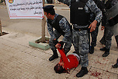 SULAIMANIYAH, IRAQ: Police help a wounded protester after security forces open fired on a demonstration...Kurdish security forces shot and killed protesters in the northern Iraqi city of Sulaimaniyah...Photo by Sartep Osman