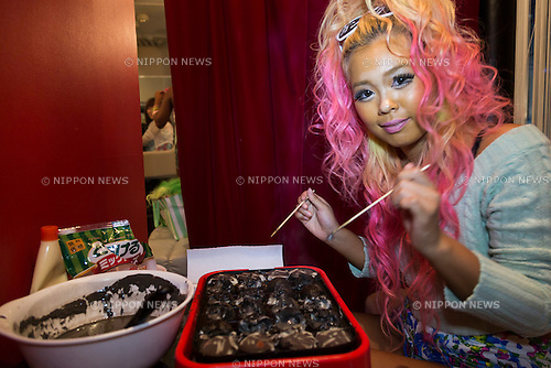 Pomitan (24), store manager, prepares bar's original food Ganguro Balls at the Ganguro Cafe &amp; Bar in the Shibuya shopping area on September 4, 2015. <br /> <br /> Ganguro is an alternative Japanese fashion trend which started in the mid-1990s where young women, rebelling against the traditional idea of Japanese beauty, wore colorful make-up and clothes and had dark-skin.<br /> <br /> 10 Ganguro fashion girls work in the new bar, which offers original Ganguro Balls (fried takoyaki style sausage balls in black squid ink batter) on its menu. Ganguro Caf&eacute; &amp; Bar also offers special services such as Ganguro make-up and the chance to take purikura (photo booth pictures) with staff and to look like a Ganguro girl walking around the Shibuya streets.<br /> <br /> The bar is popular with both Japanese and foreigners and has menus translated in English. (Photo by Rodrigo Reyes Marin/AFLO)