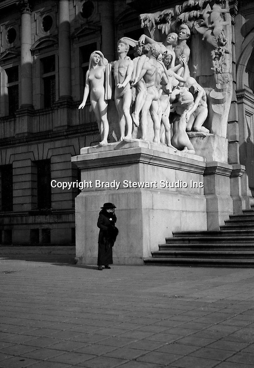 Washington DC: Sarah Stewart shading her eyes in front of the nude statue - 1912.  Brady and Sarah Stewart were sightseeing while on their honeymoon.
