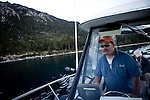 Fred Jackson pilots his boat in Lake Tahoe at Sand Harbor to collect their crayfish traps near Incline Village, Nevada, July 8, 2012. The Jacksons are the first to commercially harvest crayfish in Lake Tahoe.