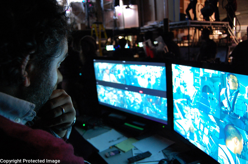 Eugenio watches the live feeds from several cameras permanently installed in the set.