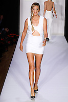 Professional Tennis Player Victoria Azarenka walks the runway in an outfit by Samantha Black, from the Samantha Black Spring Summer 2012 collection, during Style 360 Fashion Week Spring 2012.