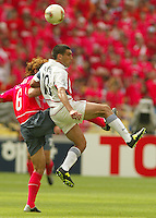 Claudio Reyna leaps for a header. The USA tied South Korea, 1-1, during the FIFA World Cup 2002 in Daegu, Korea.