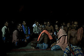 Villagers meet after dusk to take account of the day and discuss their strategy on how to tackle the problem of land acquisition by Posco. many villagers take on the responsibility to guard the gate leading to their village Dingkhia in Orissa, India. These villagers have formed an agitating group, &quot;Posco Pratirdh Sangram Samiti&quot; to oppose the construction of Posco port in their village.