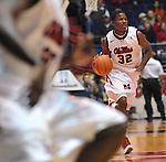 "Mississippi's Jarvis Summers dribbles upcourt against Miami at the C.M. ""Tad"" Smith Coliseum in Oxford, Miss. on Friday, November 25, 2011. (AP Photo/Oxford Eagle, Bruce Newman)."
