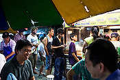 Locals wait for their turn at the famous Fried Oyster stall in Gurney Drive, Georgetown in Penang, Malaysia. Photo: Sanjit Das/Panos
