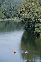 Boaters and fishermen enjoy the scenic Upper Delaware River as they float past the Roebling Bridge between Minisink Ford, NY and Lackawaxen, PA. The Upper Delaware Scenic and Recreational River, part of the National Park Service's Wild and Scenic Rivers System, stretches 73.4 miles along the New York - Pennsylvania border.<br />