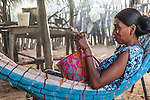 "Young Wayuu indigenous woman knitting a ""mochila"" or traditional handbag in her home in a ""rancheria"" or rural Wayuu settlement.  Knitting, crocheting and weaving are fundamental to the social and economic lives of Wayuu women in La Guajira, Colombia."