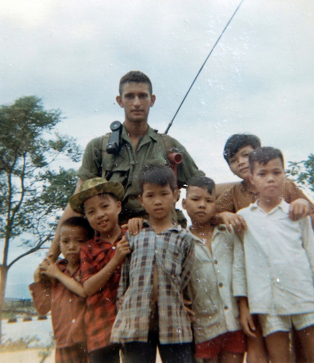 Chuck Atkins, chief of staff for Rep. Bart Gordon, D-Tenn., poses with children during his tour in the Vietnam War.