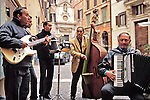 Street musicians playing near the Campo di Fiori in Rome, Italy