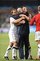 U.S. coach Bob Bradley celebrates with defenders Steve Cherundolo and Carlos Bocanegra. The United States won Group C of the 2010 FIFA World Cup in dramatic fashion, 1-0, over Algeria in Pretoria's Loftus Versfeld Stadium, Wednesday, June 23rd..