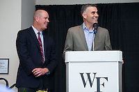 """Wake Forest baseball head coach Tom Walter (right) prepares to introduce guest speaker Jim Abbott at the Wake Forest Baseball """"First Pitch"""" Dinner on February 9, 2017 in Winston-Salem, North Carolina.  (Brian Westerholt/Four Seam Images)"""