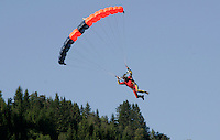 Skydiver about to land. The Extremesport Week, Ekstremsportveko, is the worlds largest gathering of adrenalin junkies. In the small town of Voss enthusiasts in a varitety of extreme sports come togheter every summer to compete and play. Norway..©Fredrik Naumann/Felix Features.