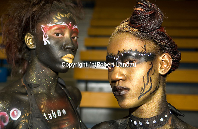 Female models painted for a promotion for Taboo before a show at Caribbean Fashion Week at the Sports Arena in Kingston