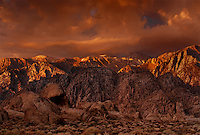 711700239 dawn light turns the eastern sierras and storm clouds gold in the alabama hills blm lands in california