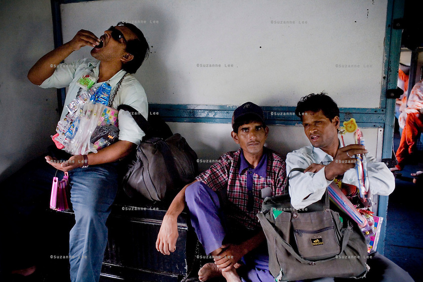 Two blind men and a chai wallah take a break from work on the Himsagar Express 6318 as it passes through Maharashtra on 8th July 2009.. .6318 / Himsagar Express, India's longest single train journey, spanning 3720 kms, going from the mountains (Hima) to the seas (Sagar), from Jammu and Kashmir state of the Indian Himalayas to Kanyakumari, which is the southern most tip of India...Photo by Suzanne Lee / for The National