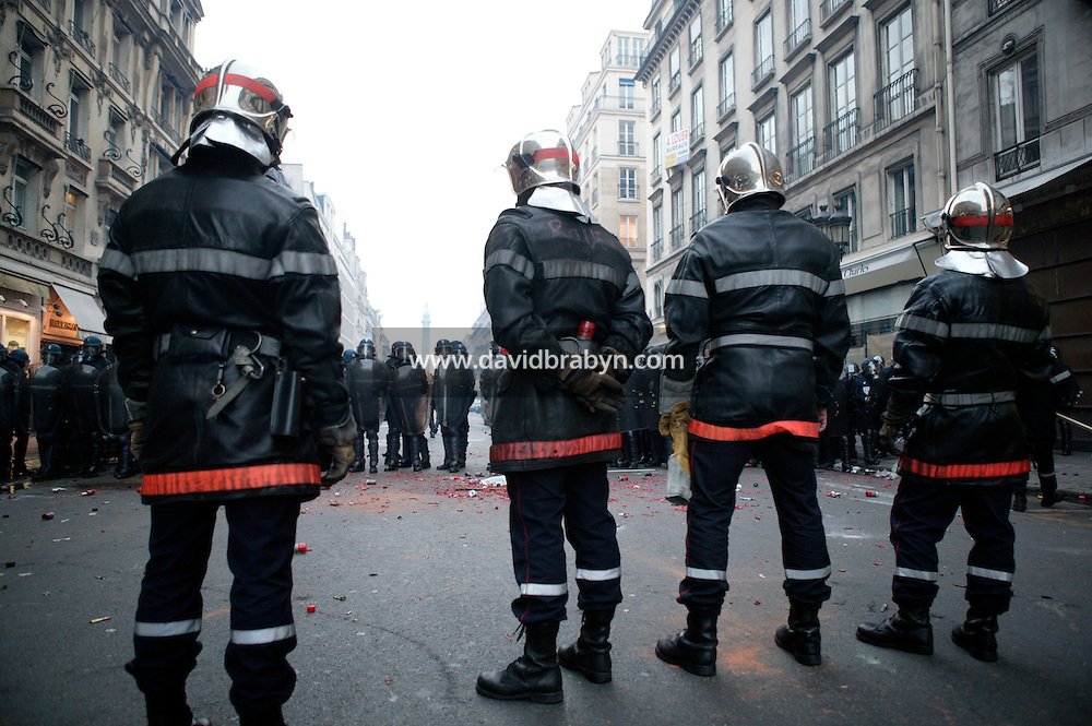 25 March 2004 - Paris, FRA -  Firefighters face riot police off the Place de l'Opera in Paris, 25 March 2004. The firefighters earlier marched through the city to demand that their profession be classified as a dangerous occupation which entails various social security benefits including early retirement. The protest ended violently leaving 2 firefighters and 20 policemen injured.