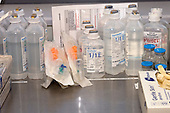 Bottles of saline solution. Royalty Free