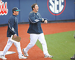 North Carolina-Wilmington pitching coach Jason Howell (right) comes out of the dugout after being ejected at Oxford-University Stadium in Oxford, Miss. on Saturday, February 25, 2012. Ole Miss won 6-4.