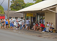 Large crowd waiting outside Matsumoto's Shave Ice's landmark Haleiwa store on Oahu's North Shore, Hawaii