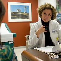 Nurse practitioner Mary Sullivan listens to an employee during an appointment in the health center at the Pitney Bowes headquarters in Stamford, CT, United States, 7 October 2008.