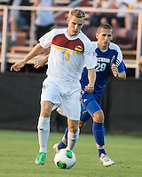 Max Hasenstab (18) of the Winthrop Eagles attacks during a game at Eagles field.  Winthrop University Eagles vs the Brevard College Tornados at Eagle's Field in Rock Hill, SC.  The Eagles beat the Tornados 6-0.  Max Hasenstab (18) runs by Winston Haddock (29) with the ball.