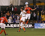 14 December 2007: Virginia Tech's Marcus Reed (9) and Wake Forest's Zack Schilawski (12). The Wake Forest University Demon Deacons defeated the Virginia Tech University Hokies 2-0 at SAS Stadium in Cary, North Carolina in a NCAA Division I Men's College Cup semifinal game.