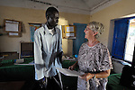 John Awol (left) teaches in the Bander Boys School, a government-run primary school in Malakal, Southern Sudan. Awol is learning better English and teaching techniques in a training program sponsored by Solidarity with Southern Sudan. Irish Sister Elizabeth Ryan, FCJ (right), an instructor in the program, reviews a lesson plan with Awol. NOTE: In July 2011 Southern Sudan became the independent country of South Sudan.