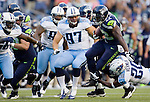 Seattle Seahawks' running back Robert Turbin runs pass an attempted tackle by the Tennessee Titans cornerback Alterraun Verner in a pre-season game at CenturyLink Field in Seattle, Washington on August 11, 2012. ©2012. Jim Bryant Photo. All Rights Reserved..