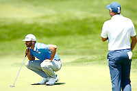 Dustin Johnson lines up his putt on the 18th green during the 2016 U.S. Open in Oakmont, Pennsylvania on June 17, 2016. (Photo by Jared Wickerham / DKPS)