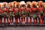 Not long ago the hill tribes of Papua New Guinea frequently competed for land with bloody skirmishes fought with long spears and bow and arrows. Today the Papua New Guinea government has successfully channeled the tribe's naturally competitive nature by holding annual dance competitions. The tribes with the most elaborate dress and choreographed dance take home cash prizes