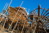Traditional wooden fishing vessels are seen being built in an artisanal shipyard on the beach in Manta, Ecuador, 8 September 2012. The construction process takes 3-4 months to complete, depending on the ship size and purpose (fish capture methods). Although a wooden boat tends to be more stable on the sea and less expensive to build (up to $0.5 million USD), it needs a maintenance every 2 years, while a fiberglass-made boat, costing almost double the wooden one, may serve 5-6 years without any repairs. The shipyard produces 6-8 vessels every year.