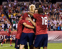 Juan Agudelo (18), Brek Shea (17) and Jose Torres (11) celebrate the goal of teammate Robbie Rogers (16) during the game at Lincoln Financial Field in Philadelphia, PA. The USMNT tied Mexico, 1-1.