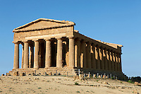 Low angle oblique view of the Temple of Concord, 5th century BC, Agrigento, Sicily, Italy,  pictured on September 11, 2009, in the morning. Well preserved owing to its 6th century AD conversion to a church, the Temple of Concord is a typical example of optical correction whose tapering columns create the illusion of a perfectly aligned building. Its frieze consists of alternating triglyphs and metopes, and the pediment is undecorated. The Valley of the Temples is a UNESCO World Heritage Site. Picture by Manuel Cohen.