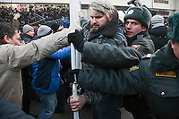 Moscow, Russia, 10/03/2012..Demonstrators scuffle with police and security after up to 20,000 people protest in central Moscow against Vladimir Putin's victory in the Russian presidential election.