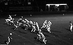 Bethel Park PA:  Offensive play with Mike Stewart 11 throwing a flat pass to Chip Huggins 32. Good blocks by Jim Dingeldine 73 and Clark Miller 30.  Tom Skladany 86 played flanker on this play. Others in the photo; Don Troup 51, Gary Biro 81, Glenn Eisaman, Joe Barrett 75, Dennis Franks 66. The offense and defense did not play well in the 12-6 defeat vs Montour. Montour's quarterback, Jim Daniels, killed the Blackhawks.  Jim Daniels was played his college ball at Pitt.  The defensive unit was one of the best in Bethel Park history only allowing a little over 7 points a game.