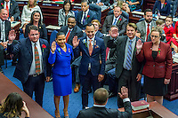 TALLAHASSEE, FLA. 11/22/16-Rep. Randy Fine, R-South Brevard County, left, Rep. Amy Mercado, D-Orlando, Rep. Carlos Smith, D-Orlando, Rep. Thad Altman, R-Indianlantic, and Erin Grall, R-Vero Beach take the oath of office from Judge Nicholas Thompson during the organizational session of the legislature at the Capitol in Tallahassee.<br /> <br /> COLIN HACKLEY PHOTO