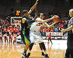 Ole Miss' Anthony Perez (13) vs. Coastal Carolina's Warren Gillis (0) and Coastal Carolina's Kierre Greenwood (55) at the C.M. &quot;Tad&quot; Smith Coliseum in Oxford, Miss. on Tuesday, November 13, 2012.