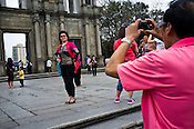 Tourists pose in front of the ruins of St. Paul's church, Macau's most famous and identifiable landmark in Central Macau, China.