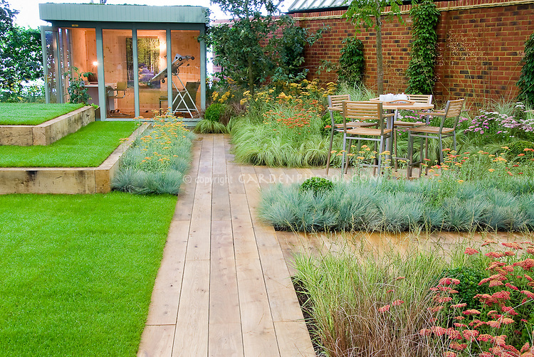 Backyard deck landscaping with wooden path garden plants for Designing gardens with grasses