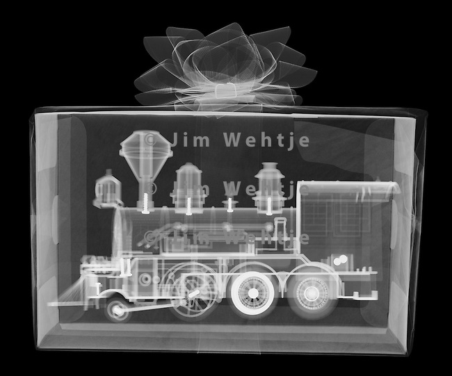 X-ray image of a toy train gift (white on black) by Jim Wehtje, specialist in x-ray art and design images.
