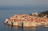 The medieval walled city with its defensive walls and 11th century Lovrijenac Fortress, and the old harbour, protected by the 14th century Fortress of St John or Mulo Tower, Dubrovnik, Croatia. The city developed as an important port in the 15th and 16th centuries and has had a multicultural history, allied to the Romans, Ostrogoths, Byzantines, Ancona, Hungary and the Ottomans. In 1979 the city was listed as a UNESCO World Heritage Site. Picture by Manuel Cohen